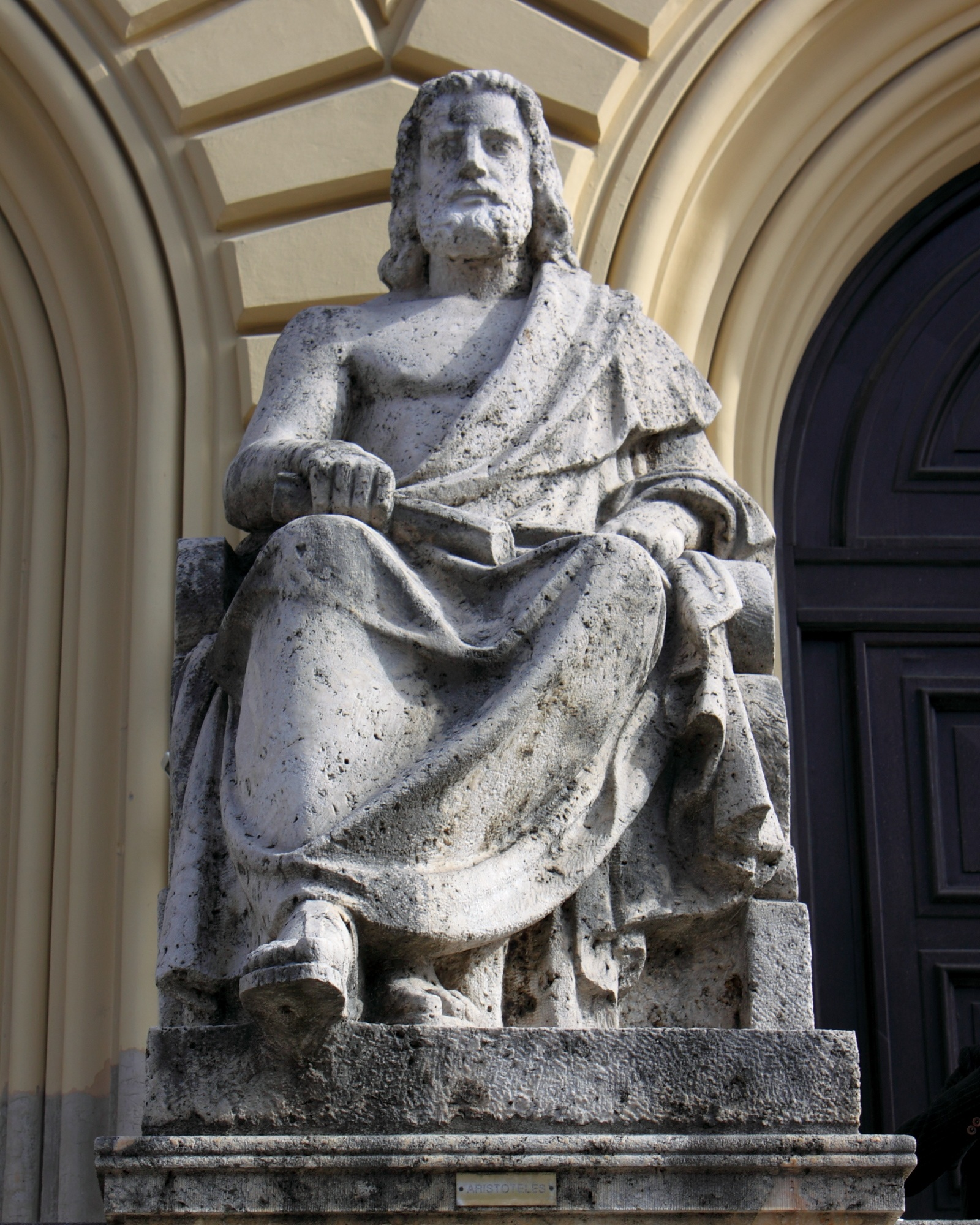 Aristotle, Aristotle was a bugger for the bottle. Statue at the entrance of the Bayerische Staatsbibliothek